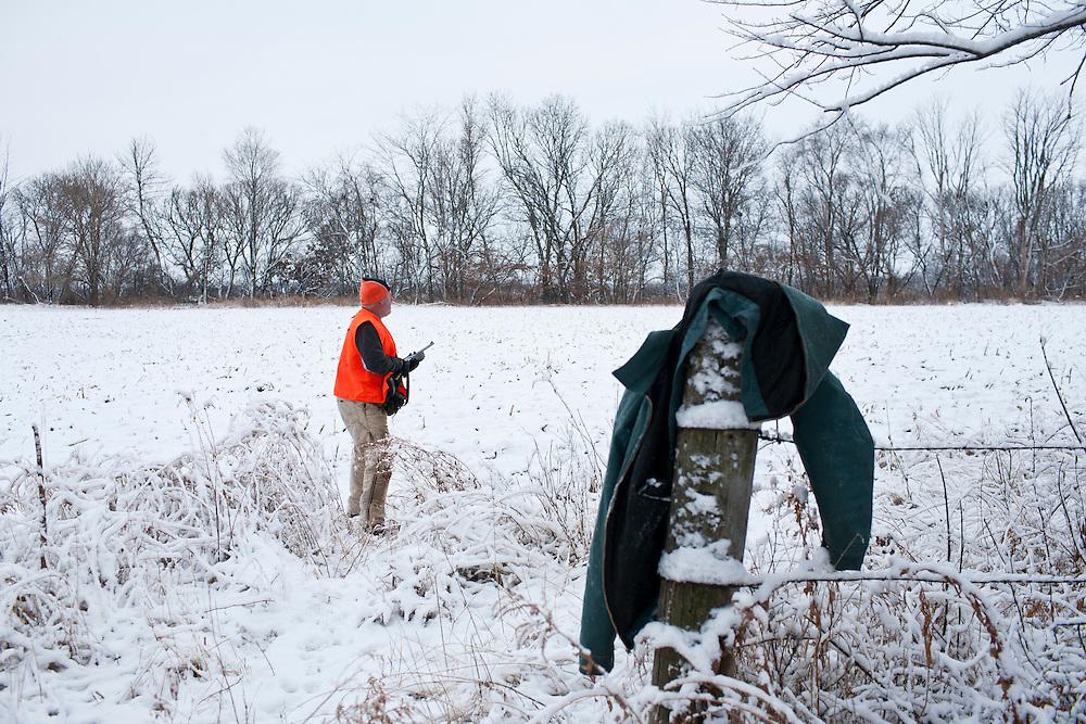 Donovan Nokes hunts deer on his property on Monday, December 5, 2011 in Webster City, IA.