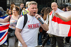 London, UK. 30th March, 2019. Pro-Brexit activists from Yellow Vests UK protest outside Downing Street during an event billed as the Great British Betrayal Rally.