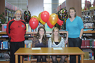 Lafayette High soccer players Andrea Colston (left) and Karly Massengill sign to play soccer for Northwest Community College, in Oxford, Miss. on Wednesday, January 25, 2012.