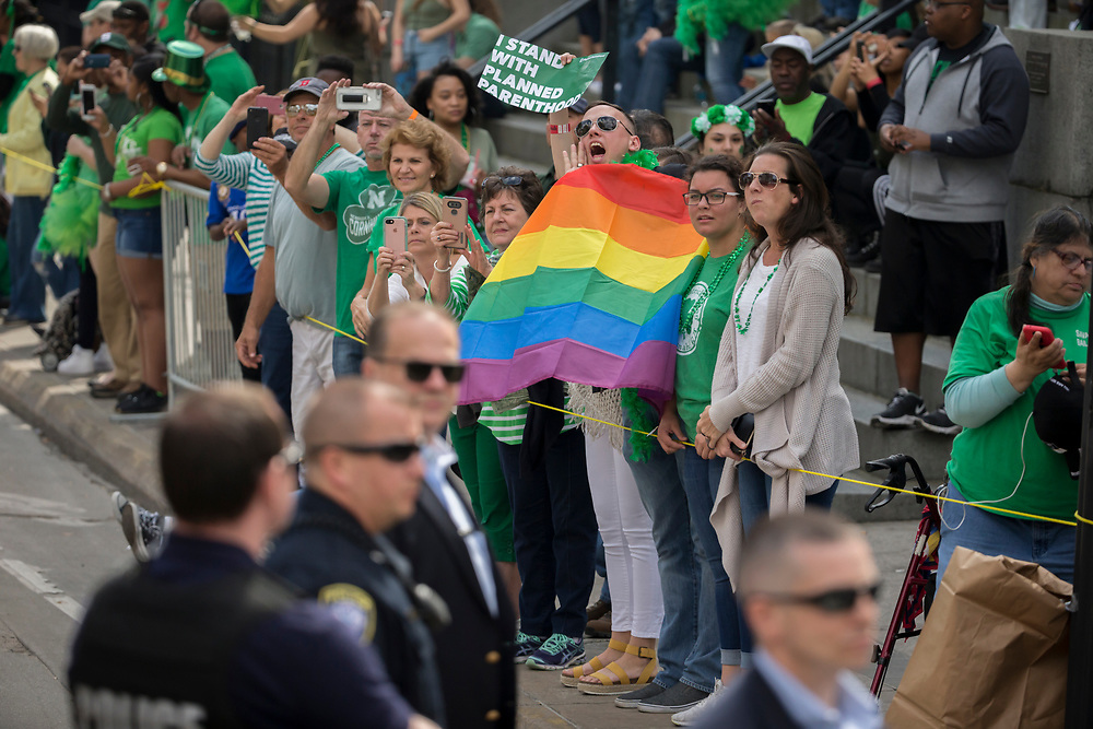A LBGTQ protester shouts at Vice President Mike Pence as he walks onto the balcony of City Hall before the start of the Savannah St. Patrick's Day parade, Saturday, March 17, 2018, in Savannah, Ga. (AP Photo/Stephen B. Morton)