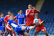 Callum Camps, Nathan Thompson during the Sky Bet League 1 match between Rochdale and Swindon Town at Spotland, Rochdale, England on 30 April 2016. Photo by Daniel Youngs.