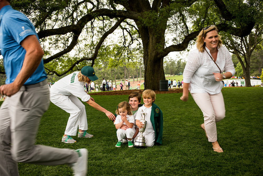 "Zach and Kim Johnson with kids under ""The Tree,"" Augusta National Golf Club, Wednesday, April 6 2016. Photograph ©2016 Darren Carroll"