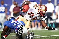 Oct 21, 2007: East Rutherford, NJ, USA: San Francisco 49ers runningback (21) Frank Gore is tackled by New York Giants cornerback (31) Aaron Ross during the first half at Giants Stadium.  Giants won 33-15..