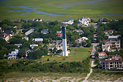Sullivan's Island Lighthouse also called the Charleston Light marks the entry to Charleston Harbor. ..Sullivan's Island, South Carolina, which is the northern entrance to Charleston harbor, was built to replace the old Charleston light on Morris Island. Construction was started in 1960, and it was first lit on June 15, 1962.The lighthouse has a steel frame, an aluminum alloy skin, and a modern triangular cross section. It is 140 ft (42.7 m) tall. The focal plane of the light is 163 ft (49.7 m) above mean sea level. The daymark is a black upper half and white lower half. It is the only U.S. lighthouse with an elevator and was the last manned lighthouse to be built...It has a DCB 24 light. It originally had 28-million candela (candlepower) that was the most powerful in the Western Hemisphere. As the light was actually too dazzling, the power was lowered to 1.2 million candela that still be seen over 26 miles. Its characteristic is two 0.2 s flashes separated by 4.8 s every 30 s. The light was automated in 1975.