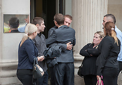 © Licensed to London News Pictures. 07/10/2015. Bristol, UK.  SAM GALSWORTHY (C), the uncle of murder victim Rebecca Watts, hugs family and friends outside Bristol Crown court at the end of the first day of the trial in the Rebecca Watts' murder case.  Photo credit : Simon Chapman/LNP