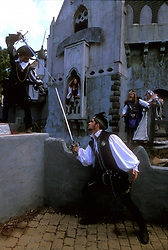 Stock photo of two costumed men sword fight at a castle at the Texas Renaissance Festival in Plantersville Texas