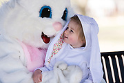 Charley Mishevic, 2, looks up at the Easter Bunny before having her photo taken during the 21st Annual Easter Egg Hunt at Winnequah Park in Monona, WI on Saturday, April 20, 2019.
