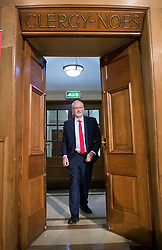 © Licensed to London News Pictures. 20/04/2017. London, UK. Labour Party leader JEREMY CORBYN walks through a door used by the clergy to vote during a General Synod meeting as he delivers his first election campaign speech in Church House in Westminster, London.. Campaigning has begun for a snap election which was called by British Prime Minister Theresa May, earlier this week. Photo credit: Peter Macdiarmid/LNP