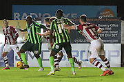 Bayo Akinfenwa of AFC Wimbledon shows some close foot work during the Sky Bet League 2 match between Exeter City and AFC Wimbledon at St James' Park, Exeter, England on 28 December 2015. Photo by Stuart Butcher.