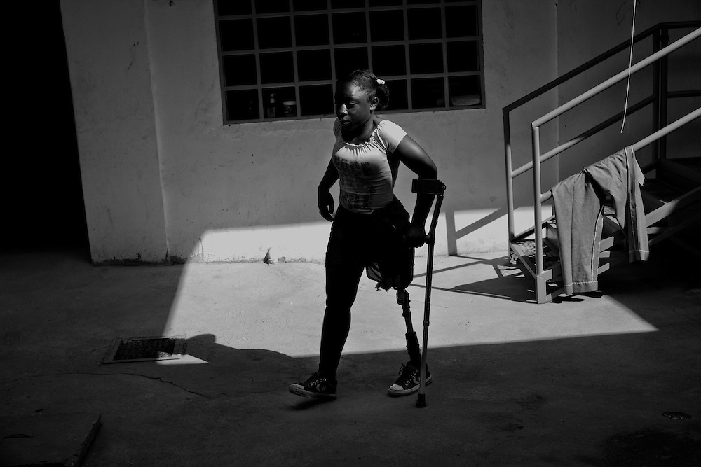 Laissa Christlensa Guerrier, 12 yrs. old, lost her left leg from the earthquake, undergoes physical therapy at Healing Hands Haiti Clinic. <br /> <br /> Healing Hands Haiti (HHH) in Port Au Prince has been established for 12 years since 1999. Currently, HHH is constructing a new facility in Port Au Prince because their old clinic was destroyed from the earthquake.   HHH provides physical therapy, counseling, prosthetics, and support for free or very little cost to Haitians.  Their funding comes from private donations and organizations such as Handicap International, Mission Europeene Aide Humanitarian, International Committee of the Red Cross (ICRC), American Red Cross, Newman's Own, Direct Relief International (DRI), SOROS Open Society Foundation, and USAID which pays for employees, doctors, supplies, and facilities.  The motto of HHH is &quot;to serve the people of Haiti is to enable them to help themselves.&quot;   Thus, most of their employees are Haitians with very few foreign expats. Furthermore, HHH recruits and teaches young Haitian students prosthetic and orthotic skills and physical therapy in a specialized program that will enable them to earn a degree approved by World Health Organization.