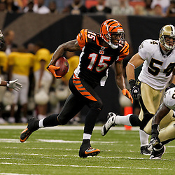 2009 August 14: Cincinnati Bengals wide receiver Chris Henry (15) runs away from the pursuit by Saints players cornerback Jason David (29), Jo-Lonn Dunbar (56) and Troy Evans (54) during a preseason opener between the Cincinnati Bengals and the New Orleans Saints at the Louisiana Superdome in New Orleans, Louisiana.