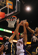 Mar. 6 2010; Phoenix, AZ, USA;  Phoenix Suns center Robin Lopez (15) puts up a shot against Indiana Pacers forward Josh McRoberts (32) and Indiana Pacers forward Danny Granger (33) in the second half at the US Airways Center. The Suns defeated the Pacers 113 to 105. Mandatory Credit: Jennifer Stewart-US PRESSWIRE.