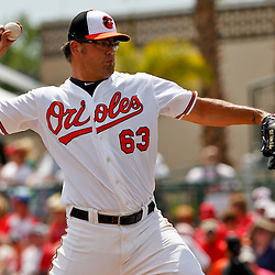 March 20, 2012; Sarasota, FL, USA; Baltimore Orioles relief pitcher Kevin Gregg (63) throws against the Philadelphia Phillies during a spring training game at Ed Smith Stadium.  Mandatory Credit: Derick E. Hingle-US PRESSWIRE