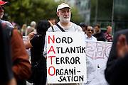 Frankfurt am Main | 30 Aug 2014<br /> <br /> Am Samstag (30.08.2014) demonstrierten &uuml;ber 200 Aktivisten aus dem Umfeld der Partei &quot;Die Linke&quot; und anderen linken und linksradikalen Zusammenh&auml;ngen gegen Krieg und f&uuml;r Frieden. Einige ukrainische Nationalisten und Aktivisten der dubiosen Montagsmahnwache in Frankfurt hatten sich unter die Friedensdemonstranten gemischt.<br /> Hier: Ein Aktivist auf der Hauptwache mit einem Plakat mit der Aufschrift &quot;Nord Atlantik Terror Organisation - NATO&quot;.<br /> <br /> &copy;peter-juelich.com<br /> <br /> [No Model Release | No Property Release]