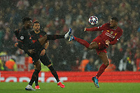 Football - 2019 / 2020 UEFA Champions League - Round of Sixteen, Second Leg: Liverpool (0) vs. Atletico Madrid (1)<br /> <br /> Liverpool's Georginio Wijnaldum wins a tackle, at Anfield.<br /> <br /> <br /> COLORSPORT/TERRY DONNELLY