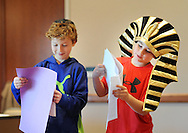 "From left, Ethan Bevington and Ben Seidler as the pharaoh perform ""Let My People Go"" as they participate in Passover Palozza in preparation for the holiday Sunday April 17, 2016 at Congregation Beth El in Lower Makefield, Pennsylvania. (Photo by William Thomas Cain)"