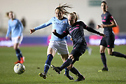 Everton midfielder Inessa Kaagman (8) and Manchester City forward Janine Beckie (11) during the FA Women's Super League match between Manchester City Women and Everton Women at the Sport City Academy Stadium, Manchester, United Kingdom on 20 February 2019.