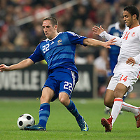 14 October 2008: French forward Franck Ribery #22 vies with Tunisian Wissem Ben Yahia #14 during the friendly football match won 3-1 by France over Tunisia on October 14, 2008, at the Stade de France in Saint-Denis, near Paris, France.