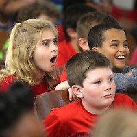 Kendall Abraham, a third grader at Lawhon Elementary School, reacts in disbelief as she watches a magic act performed by magician Jon Spade Friday during the school's big state test pep rally.