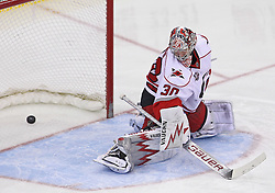 Feb 16; Newark, NJ, USA; Carolina Hurricanes goalie Cam Ward (30) allows a game winning goal to New Jersey Devils left wing Patrik Elias (26) during the third period at the Prudential Center. The Devils defeated the Hurricanes 3-2.