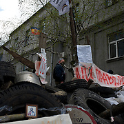 SLAVYANSK, UKRAINE - April 15, 2014: Pro-Russia activists take guard at a barricade near the police station in Slavyansk. The eastern Ukranian city was taken under control by a separatist militia early in the week and is now one of the focal points for the mega operation anti-terrorist announced by the government in Kiev.