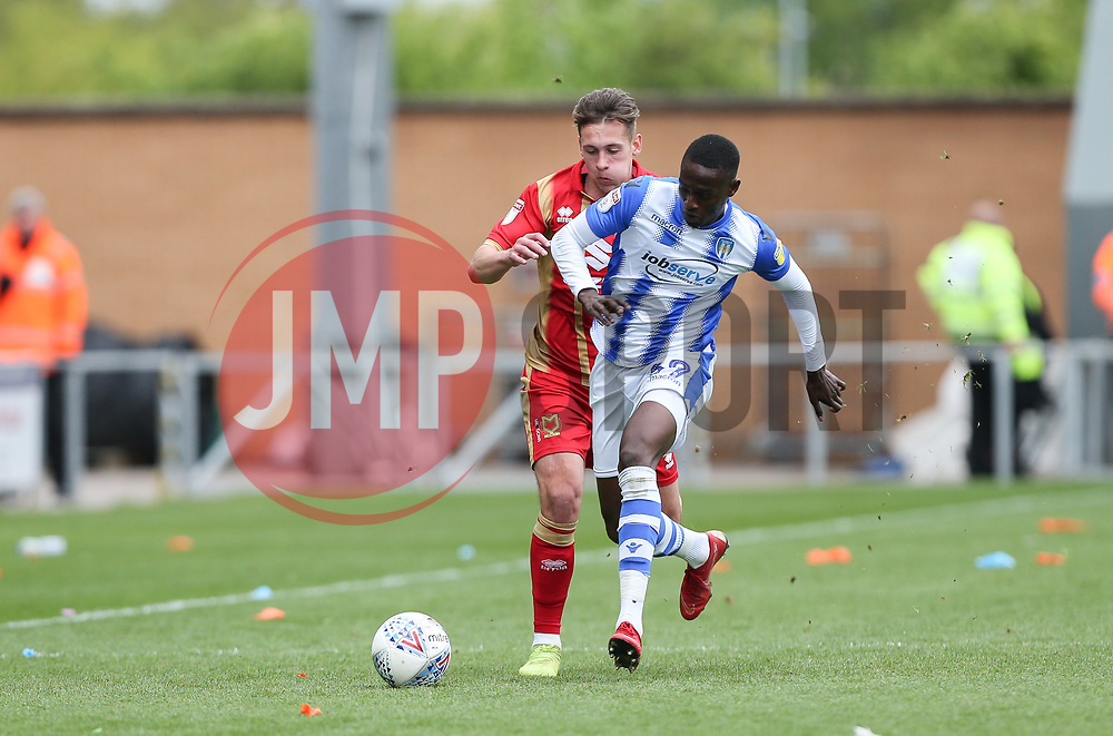 Abo Eisa of Colchester United and Callum Brittain of Milton Keynes Dons tussle for the ball - Mandatory by-line: Arron Gent/JMP - 27/04/2019 - FOOTBALL - JobServe Community Stadium - Colchester, England - Colchester United v Milton Keynes Dons - Sky Bet League Two