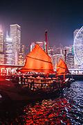Traditional Chinese junk sailing Hong Kong Harbour