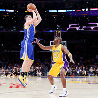 11 April 2014: Golden State Warriors guard Klay Thompson (11) takes a jumpshot over Los Angeles Lakers guard Jodie Meeks (20) during the Golden State Warriors 112-95 victory over the Los Angeles Lakers at the Staples Center, Los Angeles, California, USA.