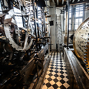 Some of the intricate mechanical workings of the Carillon that chimes the bellts of the Belfry of Bruges. The Belfry (or Belfort) is a medieval bell tower standing above the Markt in the historic center of Bruges. The first stage was built in 1240, with further stages on top built in the late 15th century. The Carillon consists of 47 bells. 26 bells were cast by Georgius Dumery between 1742 and 1748 and 21 bells were cast by Koninklike Eijsbouts in 2010. The bourdon weights 6 tons, and the bells have a combined weight of 27 tons.