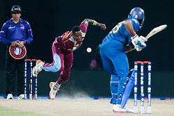 © Licensed to London News Pictures. 29/09/2012. West Indian .Fidel Edwards bowls to Tillakaratne Dilshan during the T20 Cricket World super 8's match between Sri Lanka Vs West Indies at the Pallekele International Stadium Cricket Stadium, Pallekele. Photo credit : Asanka Brendon Ratnayake/LNP