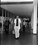 """John Huston Arrives In Dublin.   (J74)..1975..13.09.1975..09.13.1975..13th September 1975..The renowned film director,John Huston arrived in Dublin today. He had just flown in from Mexico to take part in """"Circasia 75"""" at Straffan House,Co Kildare.He is to take the part of ringmaster at the event...Pictured looking fit and well strolls through 'Arrivals' at Dublin Airport."""