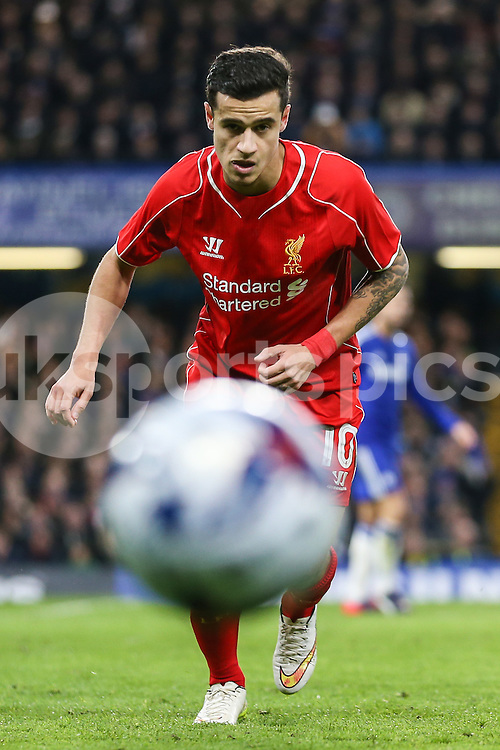 Philippe Coutinho of Liverpool chases down the ball during the Capital One Cup Semi Final 2nd Leg match between Chelsea and Liverpool at Stamford Bridge, London, England on 27 January 2015. Photo by David Horn.