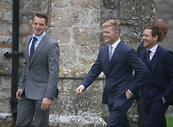 England cricket players Jos Buttler (left), Sam Billings and (centre) and Eoin Morgan (right) arrive at St Mary the Virgin, East Brent, Somerset, for the wedding of Ben Stokes and his fiancee Clare Ratcliffe.