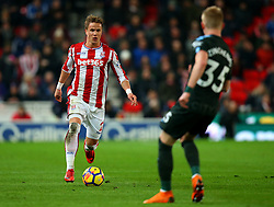 Moritz Bauer of Stoke City takes on Oleksandr Zinchenko of Manchester City - Mandatory by-line: Robbie Stephenson/JMP - 12/03/2018 - FOOTBALL - Bet365 Stadium - Stoke-on-Trent, England - Stoke City v Manchester City - Premier League