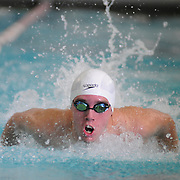 12/30/11 -- BATH, Maine.  Jake Olsen of Morse drives through the 100 yard Butterfly. He finished second behind Joey Blair of Brunswick. Morse beat Brunswick on both boys and girls sides - with scores of 90-76 and 86-80, respectively.  Photo by Roger S. Duncan.