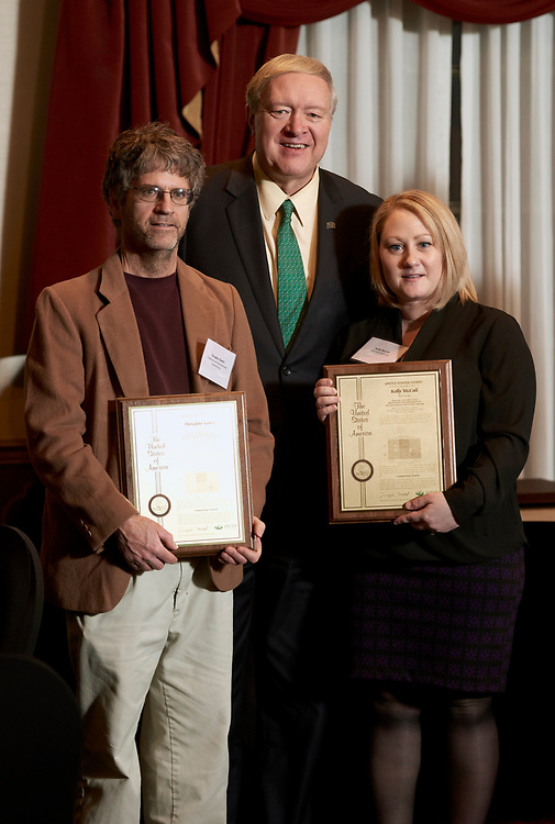 President Nellis presents Douglas Goetz and Kelly McCall their patent awards.