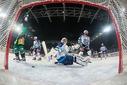 04.01.2012, Stadium Bezigrad, Ljubljana, SLO, EBEL, HDD Telemach Olimpija Ljubljana vs EC VSV 38. Runde, in picture Celebration of goalscorer Ziga Pance (HDD Telemach Olimpija, #19) and Jean Philippe Lamoureux (EC VSV, #1) during the Erste Bank Icehockey League 38th Round match between HDD Telemach Olimpija Ljubljana and EC VSV at the open ice winter classic Stadium Bezigrad, Ljubljana, Slovenia on 2013/01/04. (Photo By Matic Klansek Velej / Sportida)