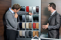 Salesperson showing color swatch to customer