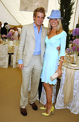 EDWARD LAWSON-JOHNSTON and ISABELLA ANSTRUTHER-GOUGH-CALTHORPE at the 2005 Cartier International Polo between England & Australia held at Guards Polo Club, Smith's Lawn, Windsor Great Park, Berkshire on 24th July 2005.<br />