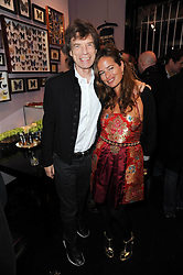 MICK JAGGER and daughter JADE JAGGER at the opening of Jade Jagger's shop at 43 All Saints Road, London W11 on 25th November 2009.