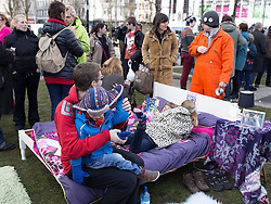 © Licensed to London News Pictures . 16/03/2013 . Manchester , UK . A staged bedroom in Piccadilly Gardens with a framed portrait of David Cameron and George Osborne on the bed side table . Hundreds of protesters opposed to changes to housing benefit , known as the Bedroom Tax , in Piccadilly Gardens in Manchester City Centre today (16th March) as part of a coordinated campaign of demonstrations in cities across the UK . The government plans to introduce changes to housing benefit from this April which will see some claimants receive a reduced amount if they have excess living space . Photo credit : Joel Goodman/LNP