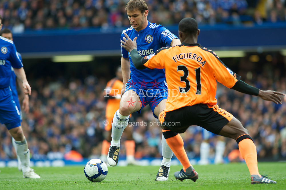LONDON, ENGLAND - Sunday, May 9, 2010: Chelsea's Branislav Ivanovic and Wigan Athletic's Maynor Figueroa in action during the final Premiership match of the season at Stamford Bridge. (Pic by Gareth Davies/Propaganda)