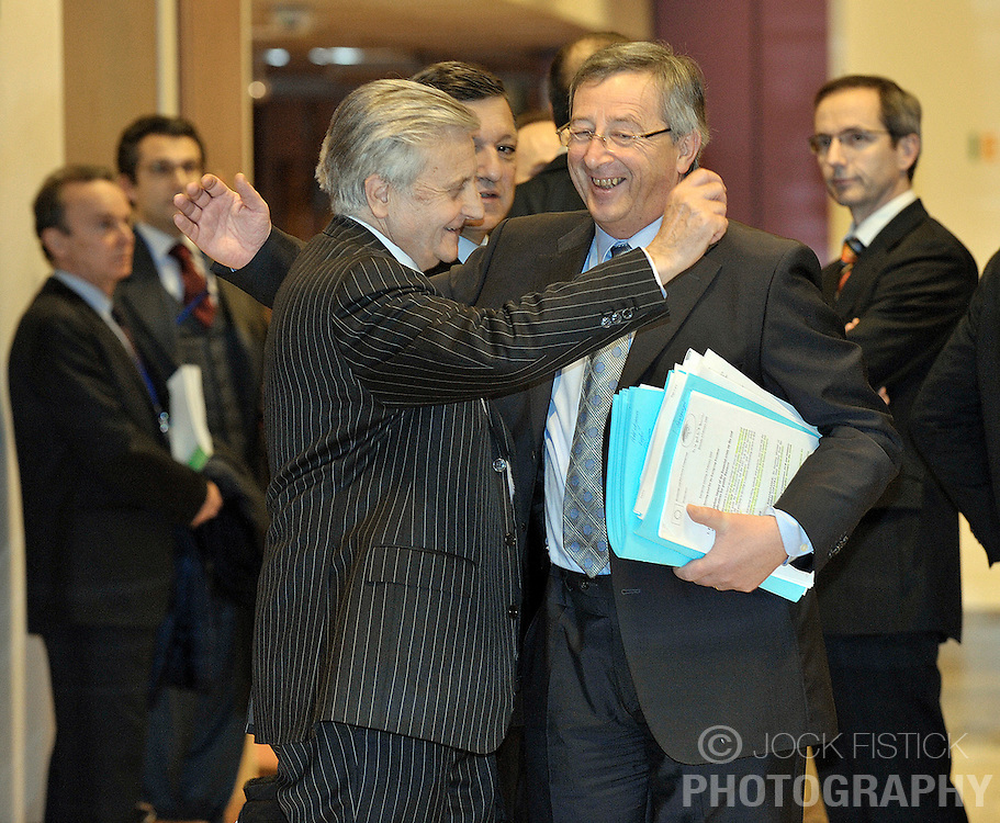 Jean-Claude Juncker, Luxembourg's prime minister and president of Euro Group, right, shares a laugh with Jean-Claude Trichet, president of the European Central Bank, left, before the start of the monthly Euro Group meeting in Brussels, Belgium, Monday, Feb. 9, 2009. (Photo © Jock Fistick)