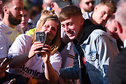 Jack Clarke of Leeds United (47) poses with a fan after arriving at the ground before the EFL Sky Bet Championship match between Leeds United and Bolton Wanderers at Elland Road, Leeds, England on 23 February 2019.
