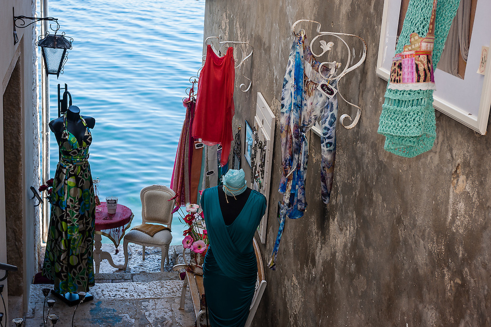 On a small alley overlooking the Adriatic, a small fashion shop sells dresses.