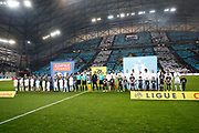 The teams line up before the French Championship Ligue 1 football match between Olympique de Marseille and Olympique Lyonnais on march 18, 2018 at Orange Velodrome stadium in Marseille, France - Photo Philippe Laurenson / ProSportsImages / DPPI