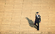 A member of the Air Force's Honor Guard makes his way down the steps of the Lincoln Memorial during an early morning photo session in Washington D.C.'s National Mall.