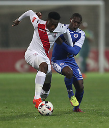 Aubrey Modiba of SuperSport United looks to tackle Moeketsi Sekola of Free State Stars during the 2016 Premier Soccer League match between Supersport United and The Free Stat Stars held at the King Zwelithini Stadium in Durban, South Africa on the 24th September 2016<br /> <br /> Photo by:   Steve Haag / Real Time Images