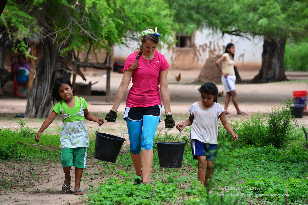Girls carrying water in Yapiroa, Izozog, Santa Cruz, Bolivia