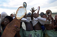 Cuban dancers performing a religious dance during the Havana's biennale in the Havana's Malecon on November 16, 2003 in Cuba. (AP Photo/Cristobal Herrera)  .
